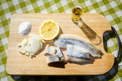 Fillet herring with onion and lemon. Fillet herring with lemon. Herring are very high in the long-chain Omega-3 fatty acids EPA and DHA. They are a source of Royalty Free Stock Images