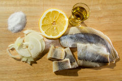 Fillet herring with onion and lemon. Fillet herring with lemon. Herring are very high in the long-chain Omega-3 fatty acids EPA and DHA. They are a source of Royalty Free Stock Photo