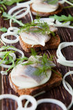 Fillet of herring on rye bread and onion rings Royalty Free Stock Photography