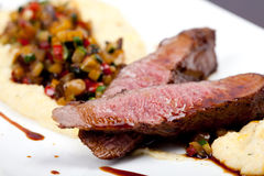 Fillet of lamb with vegetables, polenta and gravy, Royalty Free Stock Image