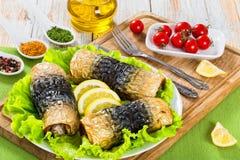 Fillet of mackerel in rolls on lettuce leaves Royalty Free Stock Photo