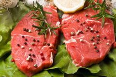 Fillet Mignon. On wood with pepper and garlic royalty free stock photos