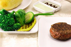 Fillet mignon. Fine fillet mignon plate with steamed vegetables Stock Images