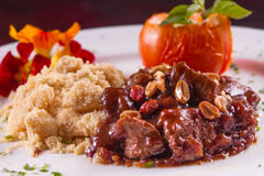 Fillet Mignon Appetizer. With egg farofa and nuts royalty free stock image