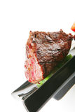 Fillet mignon on a black plate Stock Image