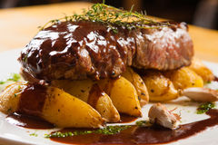 Fillet Mignon Gourmet. With rustic potatoes and garlic Royalty Free Stock Photos