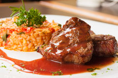 Fillet Mignon and Risotto. Fillet Mignon with wine sauce and Risotto royalty free stock images