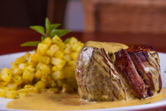 Fillet Mignon with sauce. Fillet Mignon with mustard sauce with saute potato royalty free stock photo