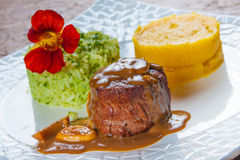 Fillet Mignon Steak. With broccoli rice and smash potatoes royalty free stock image