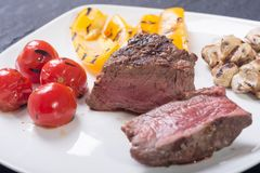 Fillet mignon steak. With grilled vegetables tomatoes , pepper , mushrooms stock images