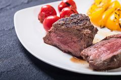 Fillet mignon steak. With grilled vegetables tomatoes , pepper , mushrooms stock photography