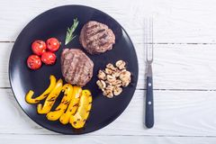 Fillet mignon steak. With grilled vegetables tomatoes , pepper , mushrooms royalty free stock photo