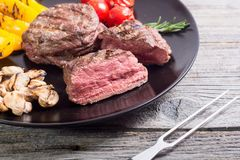Fillet mignon steak. With grilled vegetables tomatoes , pepper , mushrooms stock photo