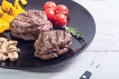 Fillet mignon steak. With grilled vegetables tomatoes , pepper , mushrooms royalty free stock images