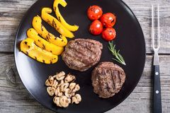 Fillet mignon steak. With grilled vegetables tomatoes , pepper , mushrooms royalty free stock image