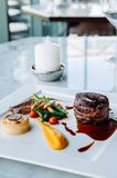 Fillet mignon steak nice fine dining style dish decoration. Fillet mignon steak in nice white plate with fine dining style dish decoration royalty free stock images