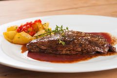 Fillet Mignon Steak. With salt, potatoes and pepper sauce stock photography