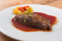 Fillet Mignon Steak. With salt, potatoes and pepper sauce stock images