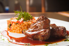 Fillet Mignon Steak. Fillet Mignon with wine sauce and Risotto Stock Photo