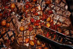 Fillet Mignon Steaks. Buffet style with tongs Stock Photos