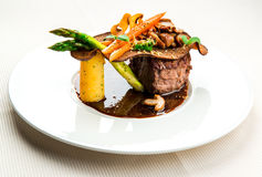 Fillet mignon with vegetables Stock Photos