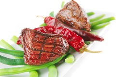 Fillet mignon on a white plate Stock Images