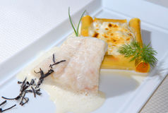 Fillet of a pike perch with canneloni stock image