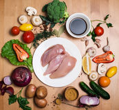 Fillet raw chicken. Fresh chicken meat on white plate on wooden Royalty Free Stock Photography