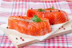 Fillet of red fish. On wooden board Royalty Free Stock Images