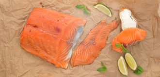 Fillet of red fish salmon on the Kraft paper Royalty Free Stock Photography