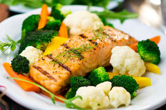 Fillet of salmon. With cooked vegetables Royalty Free Stock Images