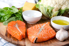 Fillet  Salmon with fresh herbs. And lemon on a board. Seafood. Stock image Royalty Free Stock Photography