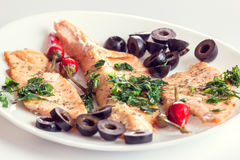 Fillet of salmon with olives, herbs and spicy red pepper Royalty Free Stock Images