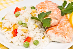 Fillet of salmon and rice with  vegetables Royalty Free Stock Photos