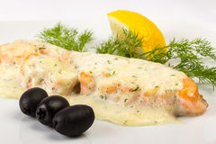 Fillet of salmon sauce with black olives Royalty Free Stock Images
