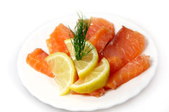 Fillet of  salty salmon with greens and  lemon Stock Images