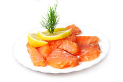 Fillet of salty salmon with greens and  lemon Stock Photography