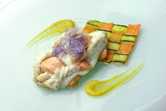 Fillet of sea bream and salmon interwoven with carrot and zucchi. Fish Dish Fillet of sea bream and salmon interwoven with carrot and zucchini Royalty Free Stock Photo