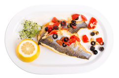 Fillet of seabass on a baked potato. Royalty Free Stock Images