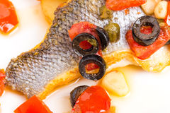 Fillet of seabass with baked vegetables. Stock Photo