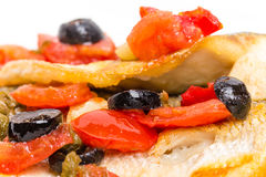 Fillet of seabass with baked vegetables. Royalty Free Stock Image