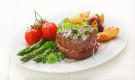 Fillet steak with asparagus and tomato Royalty Free Stock Photo