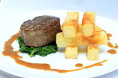 Fillet Steak with big chips. Spinach and Dijon sauce Royalty Free Stock Images