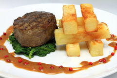 Fillet Steak. Big chipspepper sauce and spinach Stock Images
