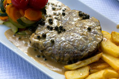 Fillet Steak with French Fries and Pepper Cream Sauce Stock Images