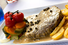 Fillet Steak with French Fries and Pepper Cream Sauce Royalty Free Stock Photos
