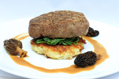 Fillet Steak on a potato rosti. Spinach and morel mushroom sauce Stock Images