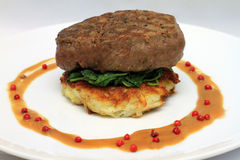 Fillet Steak. On a potato rosti, spinach and pepper sauce Royalty Free Stock Image