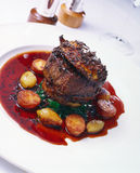 Fillet steak with red wine Stock Images