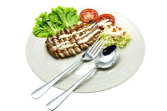 Fillet steak. Suculent thick juicy portions of grilled fillet steak served with tomatoes and  salad Stock Photography